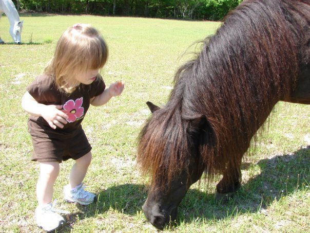 Talking to her Pony