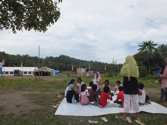 School children holding classes in open ground