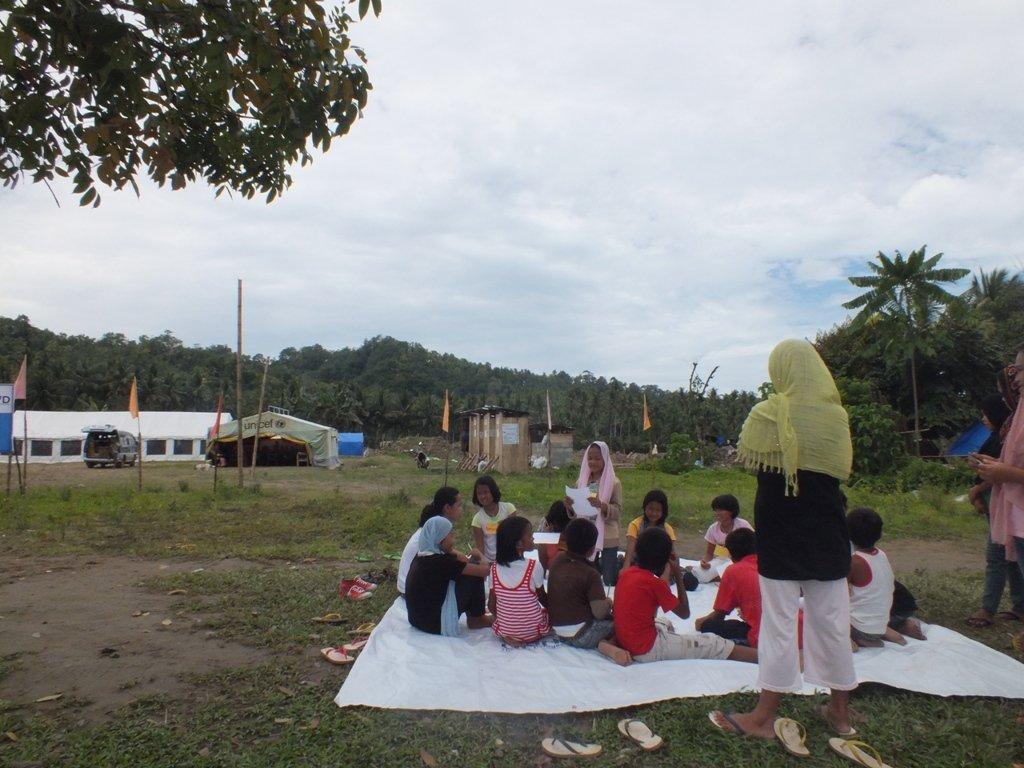 School children holding classes in open ground