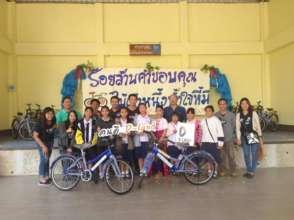 Students receiving their bikes from D-Land