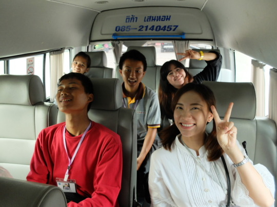 Our counselor, Lux, and the students on the bus.