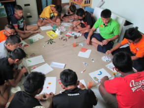 Male students join in a boys art therapy program.
