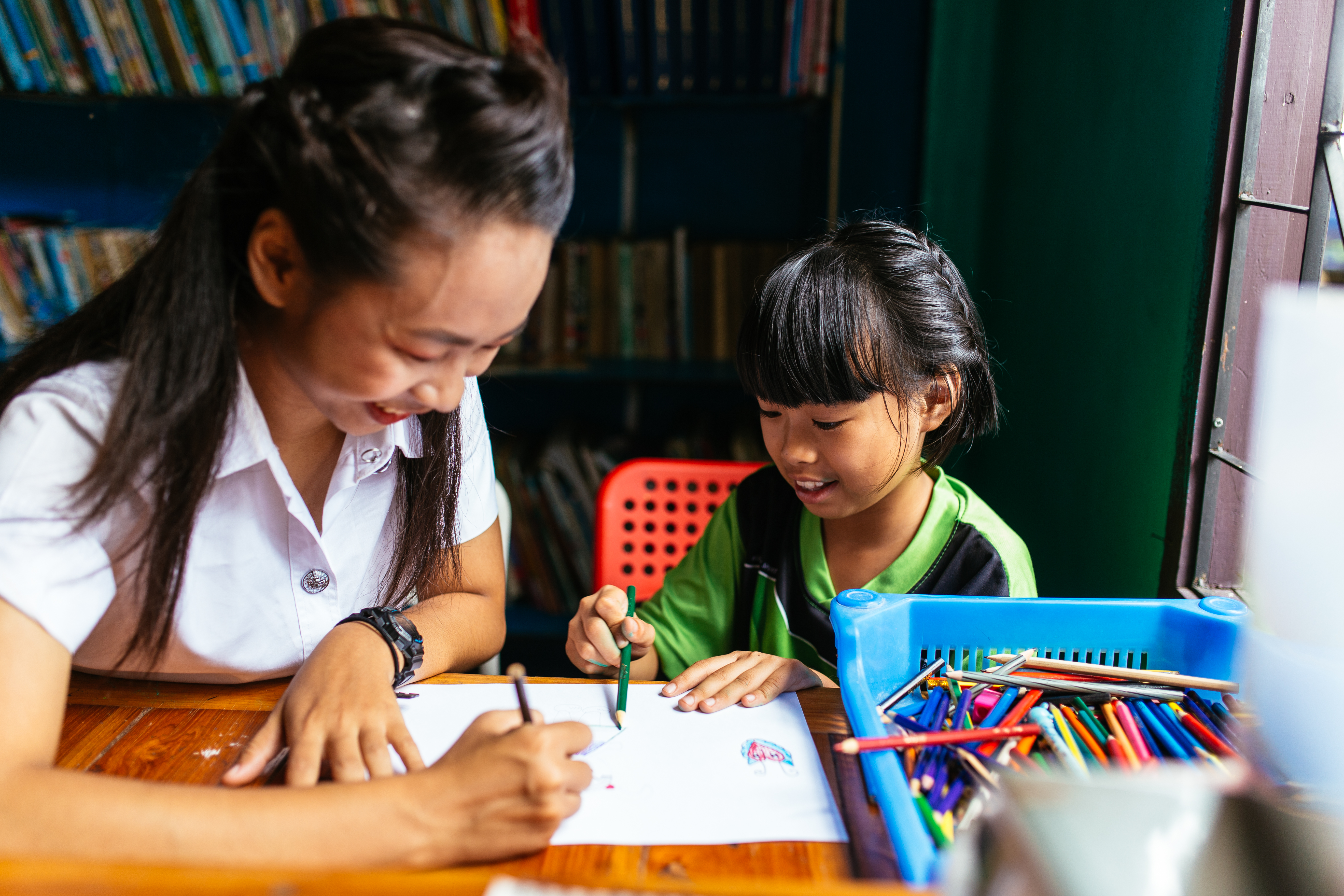In a region in northern Thailand where more than half of all girls drop out of primary school, 16 students celebrate their graduation...and plan to continue their education.