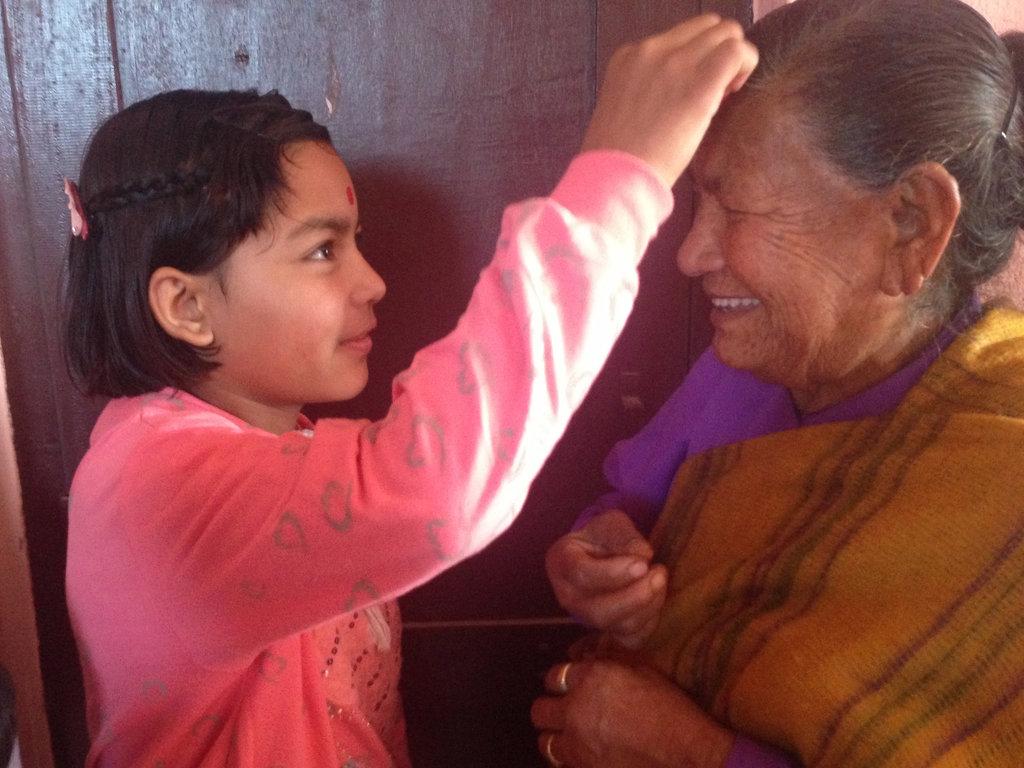 Anita gives her new Grandmother a Tika*