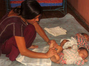 """Trained GFV caregiver Mother """"exercising"""" her baby"""