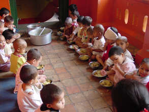 Toddlers lined up for meals