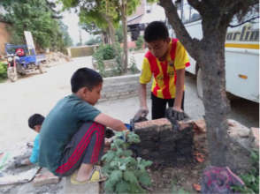 Children rebuilding a small temple
