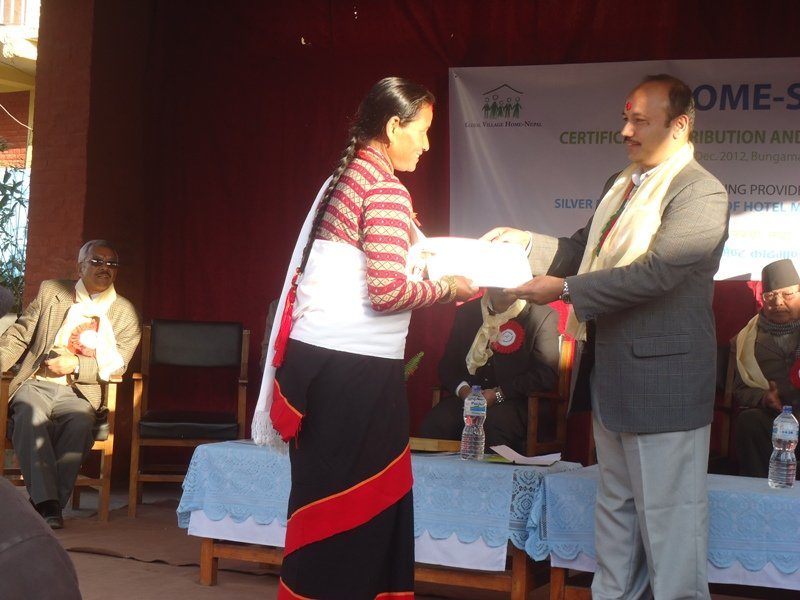 Farmer-woman graduating hospitality program.