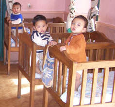 """Sad faces of children in """"institutional"""" care"""