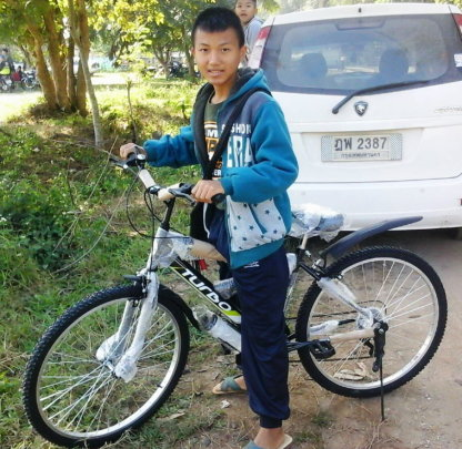 A happy Chai with his new bike