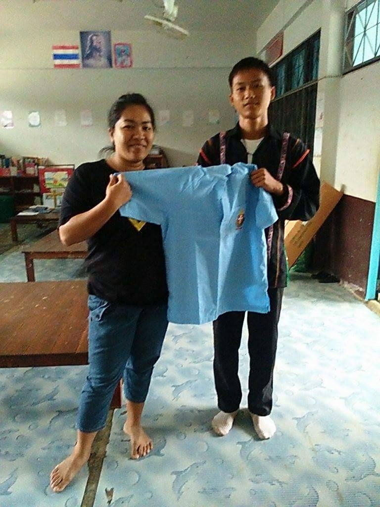 Dou receiving his uniform