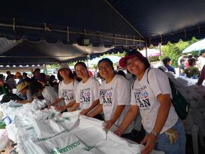 Volunteers prepare part of the 1,200,000 sandbags