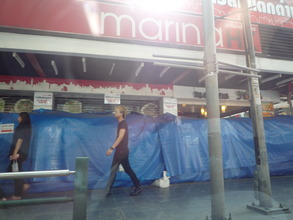 Sandbag barriers about 2m high built by shops