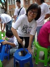 Volunteer filing the portable toilet