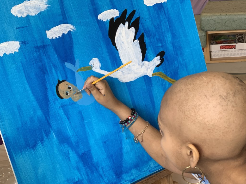Adding baby brother to painting