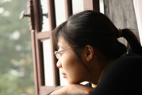 Thuy looks out at her new life