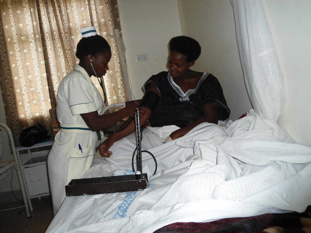 taking vital signs of admitted woman