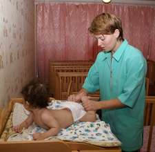 a masseuse works with a child