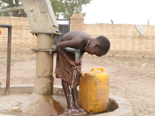 Girl at Community Well