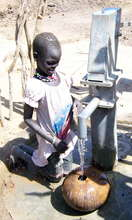 Girl getting water at well dug by Water for Sudan