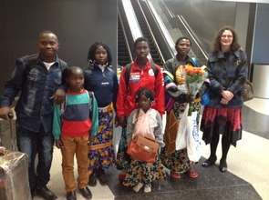 The newly-arrived family at Chicago O'Hare Airport