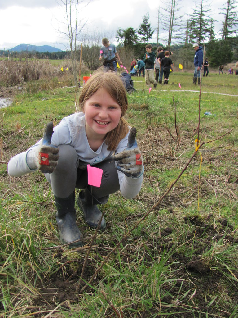 "This kid says ""thumbs up"" to habitat restoration!"