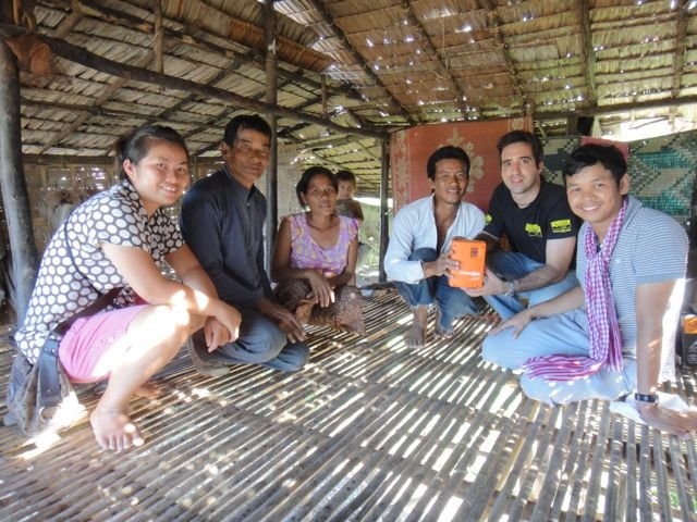 with a family that just received solar lighting