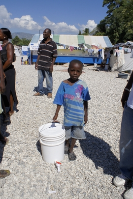 Boy with Cholera Prevention Kit