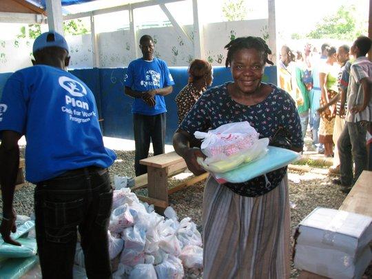 Plan Staff Distributing Cholera Prevention Kits