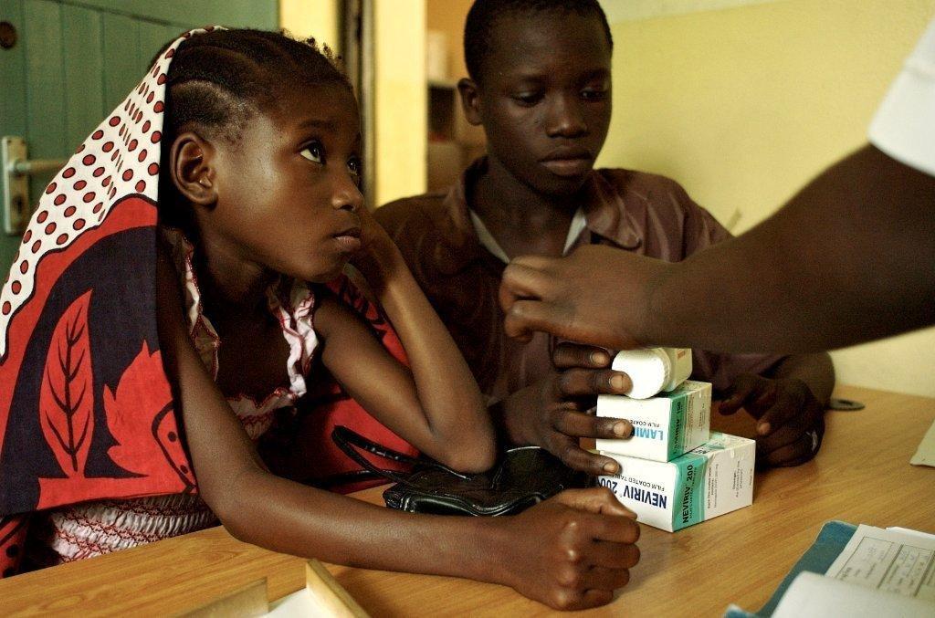 Fatuma and siblings receiving their free medicatio