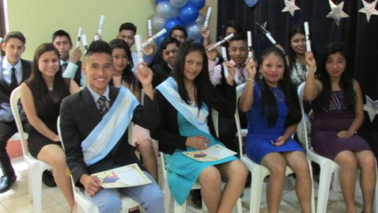 Our 9th grade graduates show off their diplomas