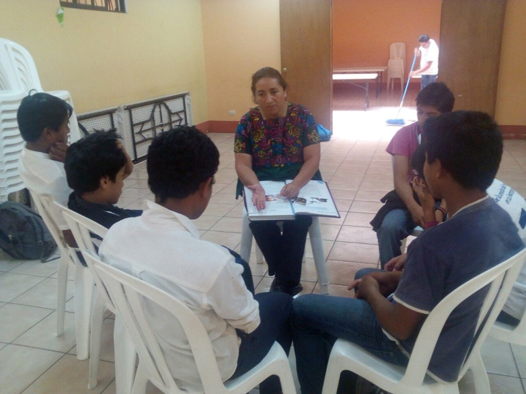 The psychologist working in a small group.