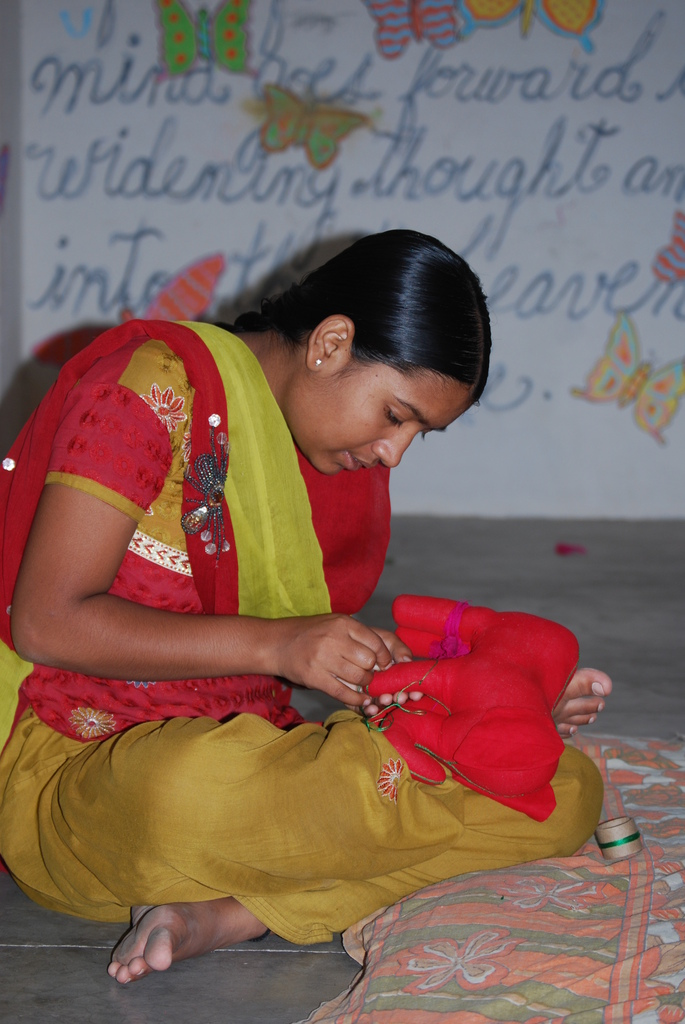 Sultana learning to sew