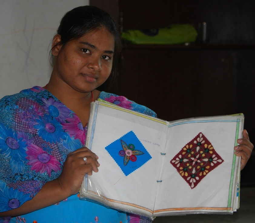 Anita showing her file of embroidery stitches
