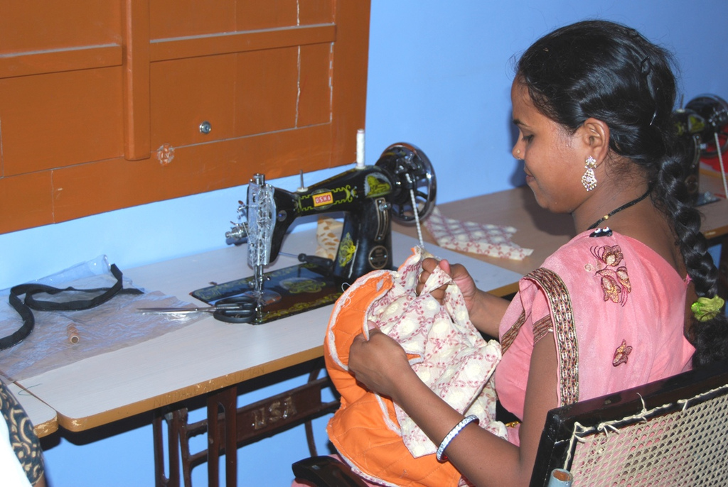 Student learning to make quilted bags