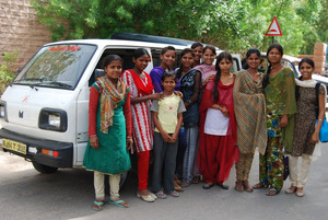Sambhali's new minivan with some of the students
