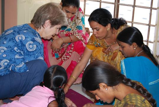 Christa, volunteer teaching the students