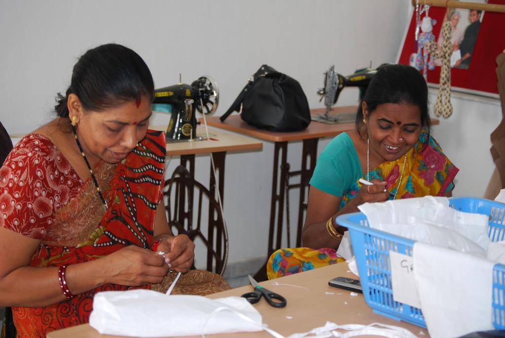 Radha and Rita sewing bolster covers