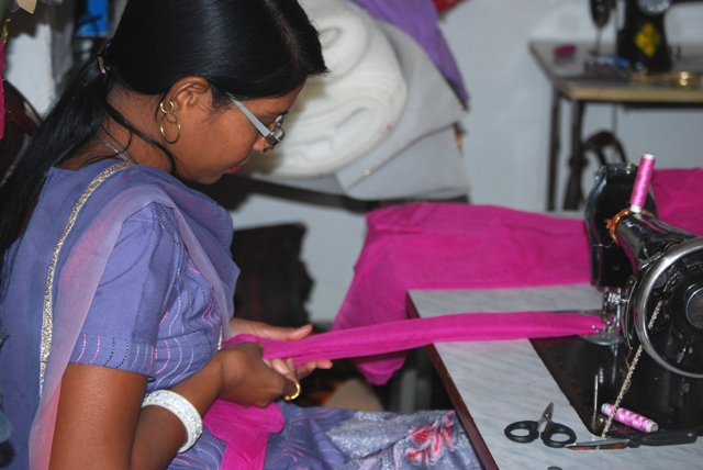 Reshma sewing curtains