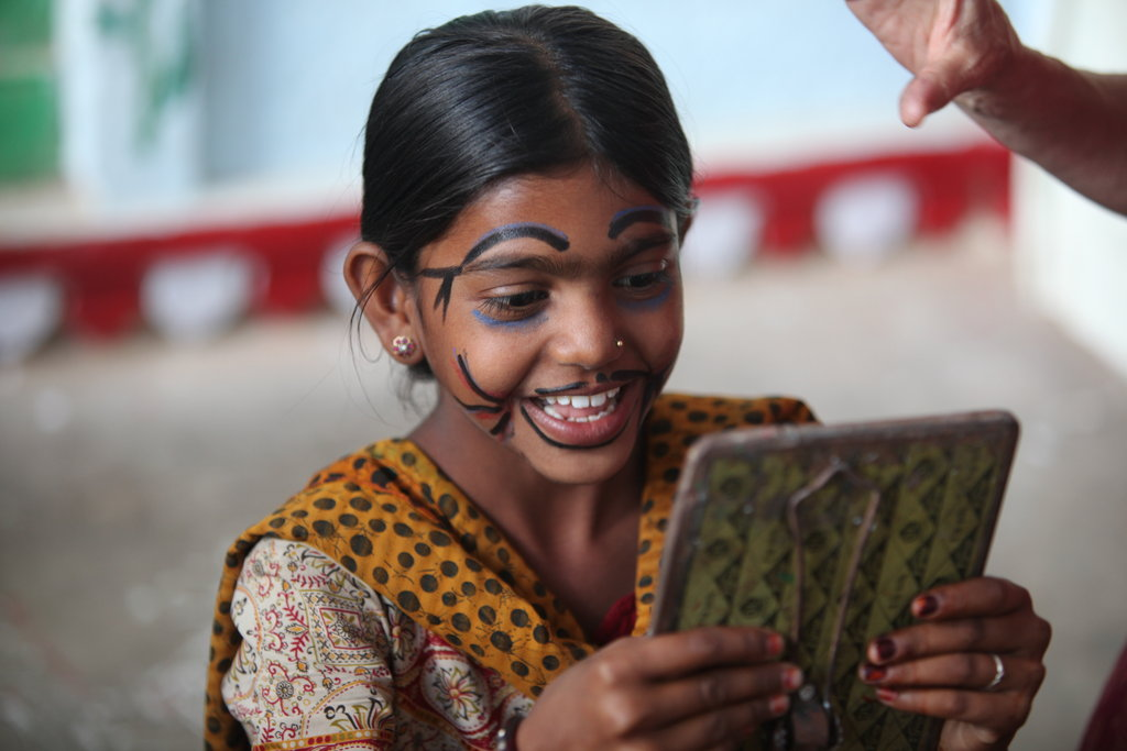 This shows one of the girls in our Setrawa Empowerment Centre taking part in a Fun Day Workshop.  During the week they learn Hindi and English and on Saturdays the children have workshops given by foreign volunteers, both educational and fun.