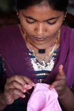 Komal sewing a bag in the Sewing Centre