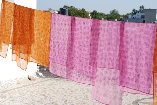 Block-printed scarves drying in the sun