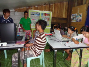 Migrant youth learning computer skills