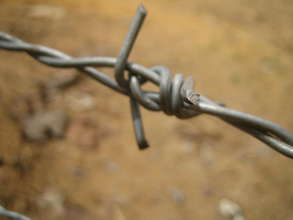 Barbed wire refugee camp fences
