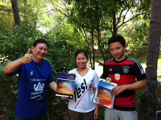 Law La Say, Chau Su and Major with the manual