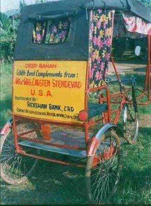 Rickshaw displaying an advertisement