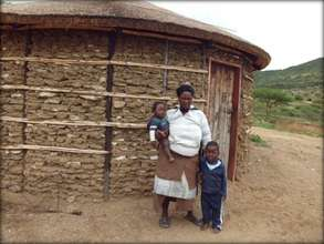 Gcinisephi and her children outside her new house
