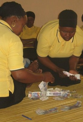Issuing loans at an SHG meeting