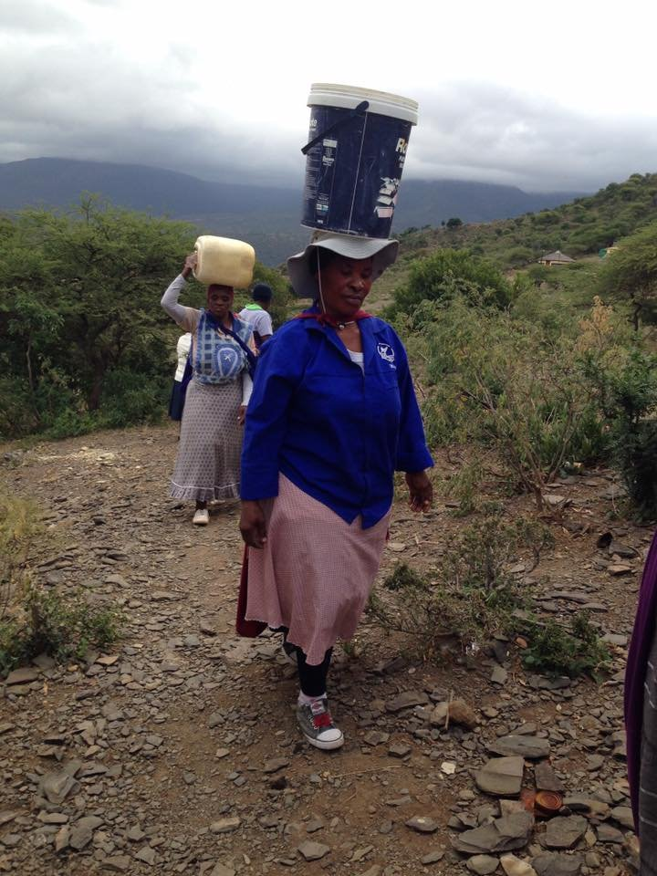CLA members carry clean water for the vulnerable