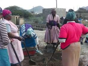Yibanathi SHG members making bricks together